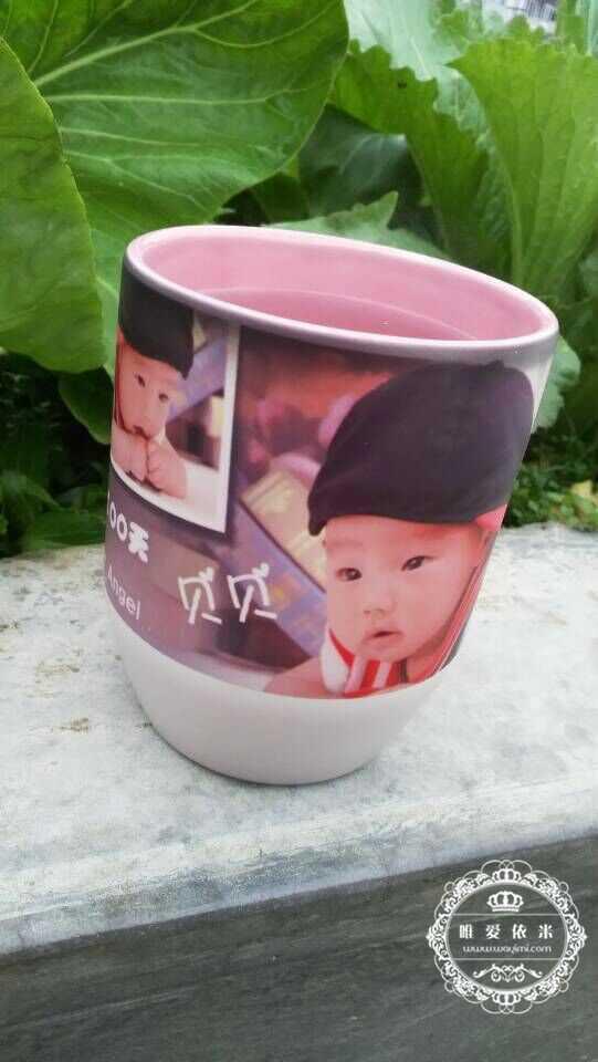 宝宝真可爱,宝妈可以像我这样把宝宝照片印在杯子上